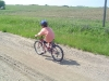 Mason riding near farm